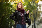 pic of jacket  - Young fashion blond woman in leather jacket in autumn park - JPG