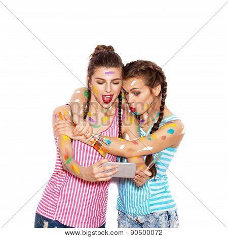 Pretty Girl Friends Having Fun. Women Smeared In Paint