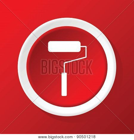 Paint roller icon on red