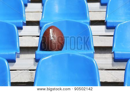 Rugby ball on stadium seat