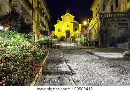 Orta, Santa Maria Assunta church, night view. Color image