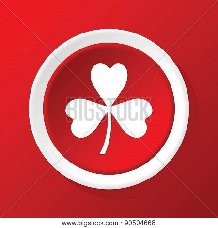 Clover icon on red
