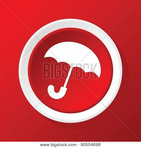 Umbrella icon on red