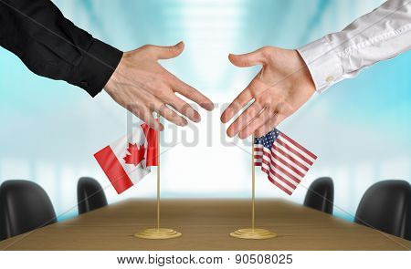 United States and Canada diplomats agreeing on a deal