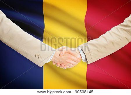 Businessmen Handshake With Flag On Background - Chad
