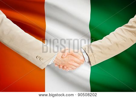 Businessmen Handshake With Flag On Background - Ivory Coast