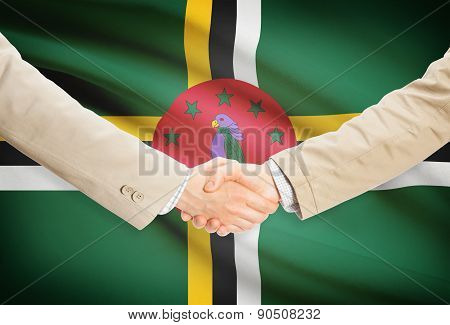 Businessmen Handshake With Flag On Background - Dominica