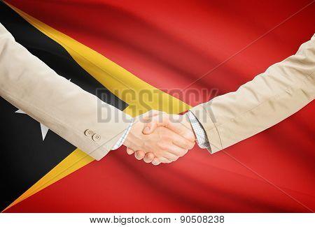 Businessmen Handshake With Flag On Background - East Timor