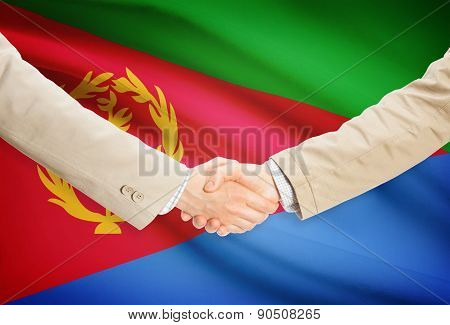 Businessmen Handshake With Flag On Background - Eritrea
