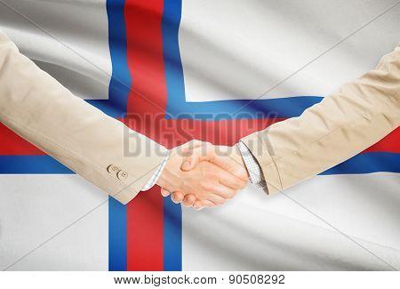 Businessmen Handshake With Flag On Background - Faroe Islands