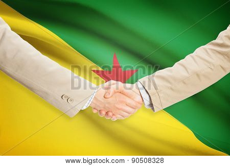 Businessmen Handshake With Flag On Background - French Guiana