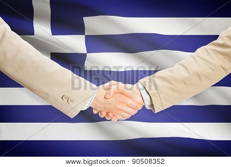 Businessmen Handshake With Flag On Background - Greece