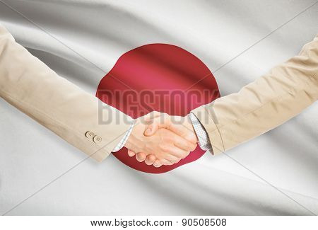 Businessmen Handshake With Flag On Background - Japan