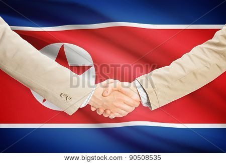 Businessmen Handshake With Flag On Background - North Korea