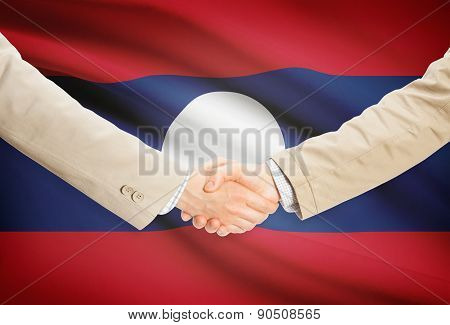 Businessmen Handshake With Flag On Background - Laos