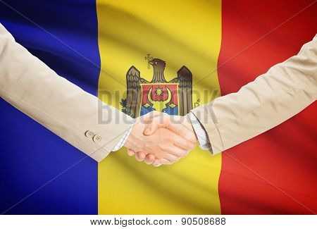 Businessmen Handshake With Flag On Background - Moldova