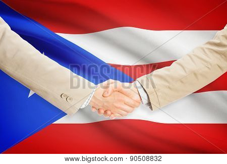 Businessmen Handshake With Flag On Background - Puerto Rico