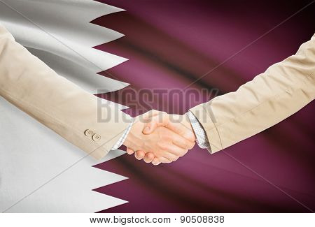 Businessmen Handshake With Flag On Background - Qatar