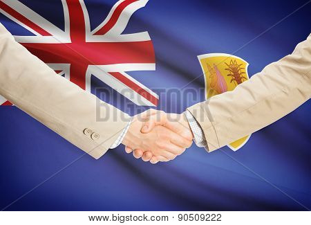 Businessmen Handshake With Flag On Background - Turks And Caicos Islands