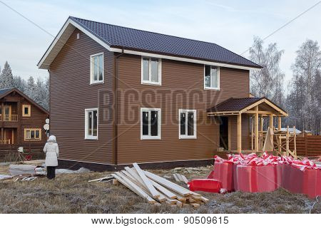 Unfinished House Trimmed With Siding