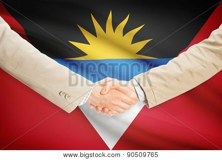 Businessmen Handshake With Flag On Background - Antigua And Barbuda
