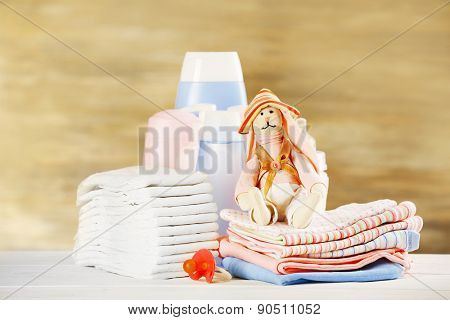 Baby accessories on table on grey background