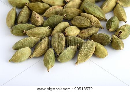 Cardamom pods on white background