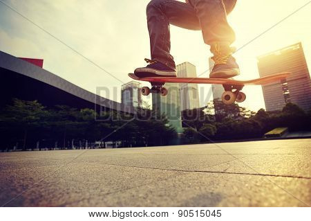 skateboarder doing skateboarding trick ollie on city