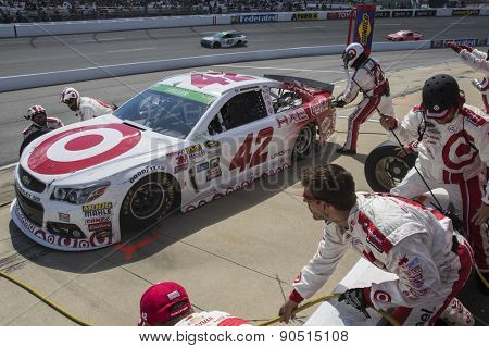 Richmond, VA - Apr 26, 2015:  Kyle Larson (42) brings his race car in for service during the Toyota Owners 400 race at the Richmond International Raceway in Richmond, VA.