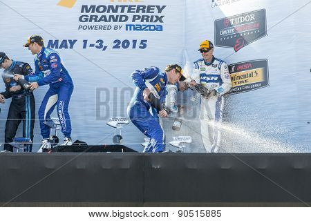 Monterey, CA - May 03, 2015:  The winning drivers celebrate in victory lane after winning the Grand Prix of Monterey at Mazda Raceway Laguna Seca in Monterey, CA.