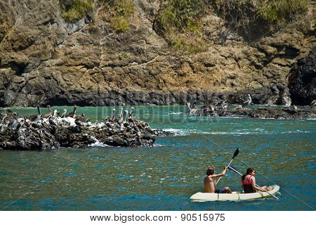 Unidentified tourists enjoying a daytrip kayaking in beautiful paradise beach, Salango island. Manab