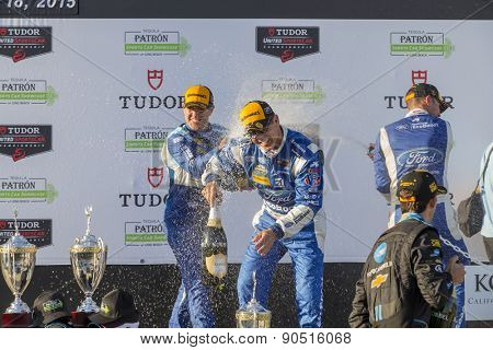 Long Beach, CA - Apr 18, 2015:  Scott Pruett and Joey Hand celebrate after a podium finish for the Tequila Patron Sports Car Racing Showcase at Long Beach Grand Prix in Long Beach, CA.