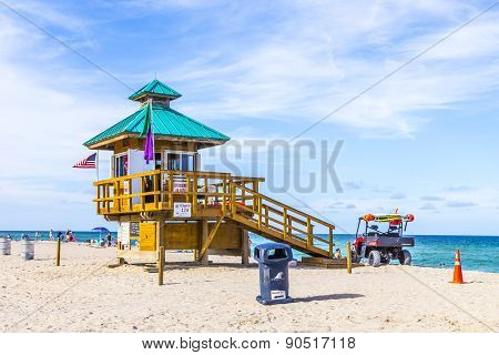 People Enjoy The Beach At Sunny Isles Protected By Lifeguards In Famous Huts.