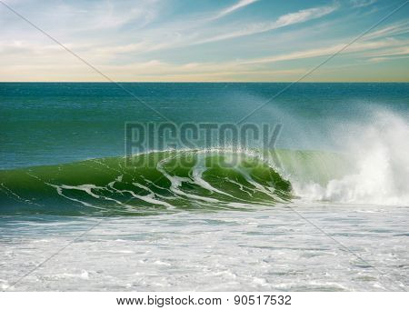 Beautiful green seascape with a perfect surfing wave