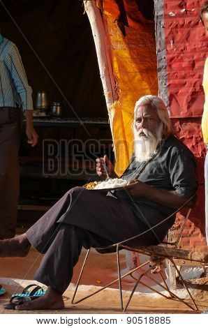Old Man Eating A Meal In Street Market In Khajuraho