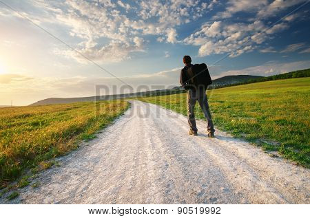 Person walk on the road lane. Traveling and tourism scene.