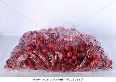 Frozen berries in bag in freezer close up