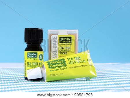 Australian Tea Tree Oil products including bottle of oil tube of cream and pack of toothpicks.