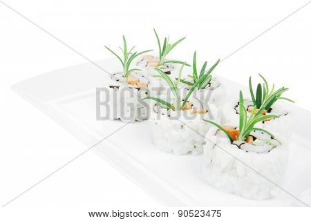 Japanese Cuisine - California Sushi Roll with Avocado, Cream Cheese and Raw Salmon inside. With wasabi and ginger. isolated over white background