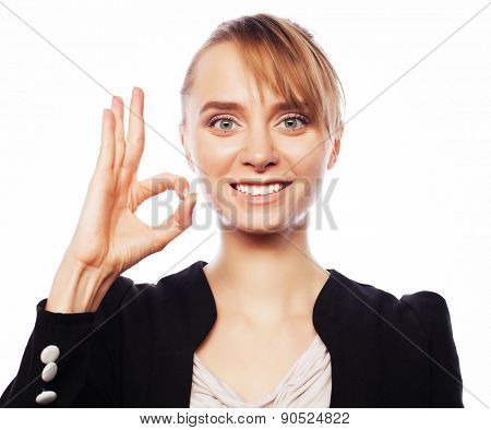 Happy smiling cheerful young business woman with okay gesture, over white background