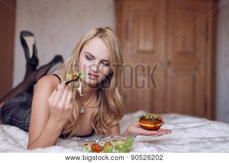 Blonde Woman Laying On Bed Hates Salad