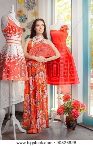 Woman in Long Red Floral Dress in Fashion Store