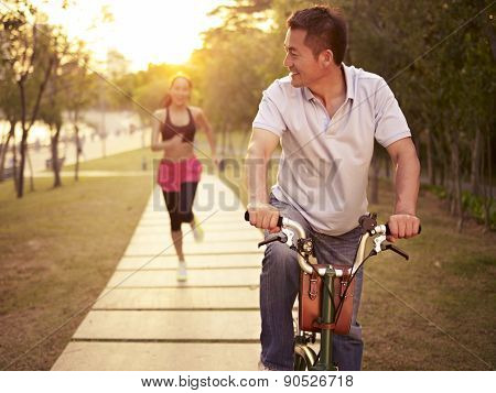 Asian Couple Enjoying Outdoor Activities