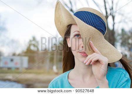 Freckled Woman Covering One Eye By Hat