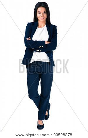 Full length portrait of a smiling businesswoman standing with arms folded over white background