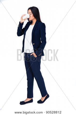 Full length portait of a businesswoman drinking coffee over white background