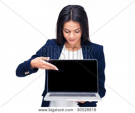 Happy businesswoman pointing on the blank laptop screen over white background