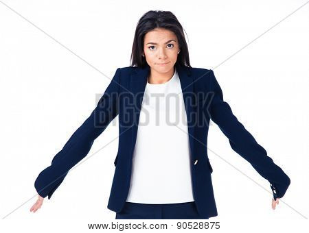 Cute businesswoman shrugging her shoulders over white background and looking at camera
