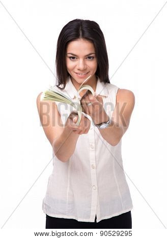 Smiling businesswoman counting money isolated on a white background. Wearing in shirt