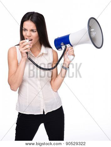 Businesswoman shouting in loudspeaker isolated on a white background. Looking away